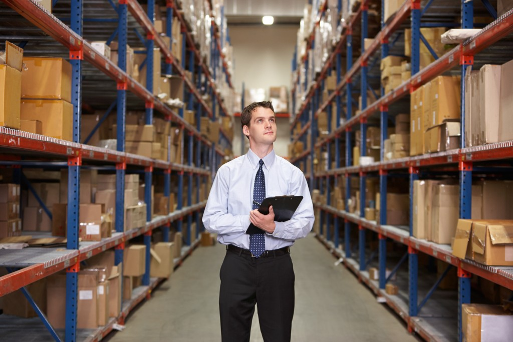 man inspecting warehouse