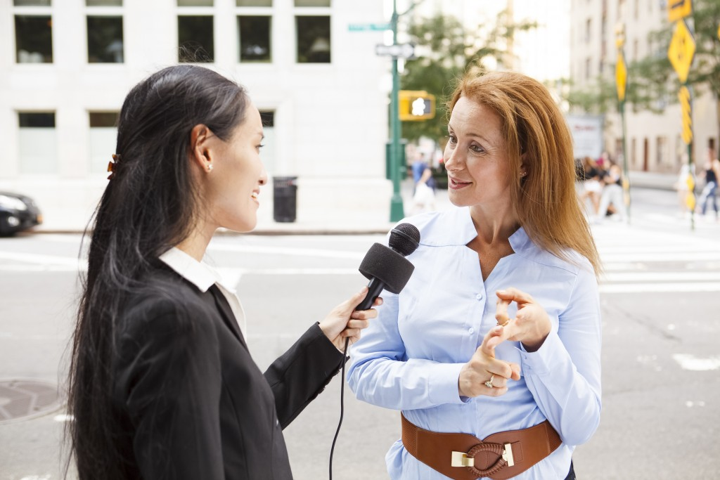 Female journalist doing an interview