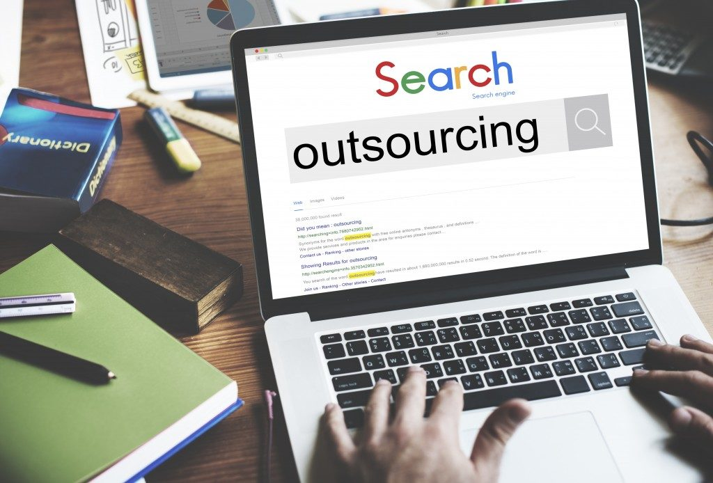 person researching the word outsourcing