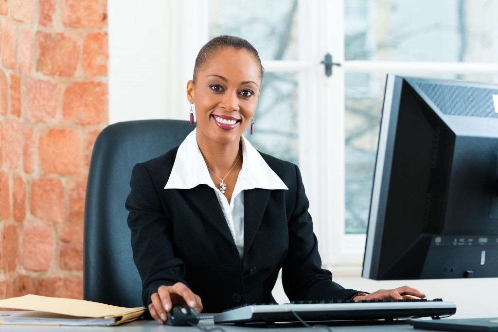 Young female lawyer or paralegal working in her office on a Computer