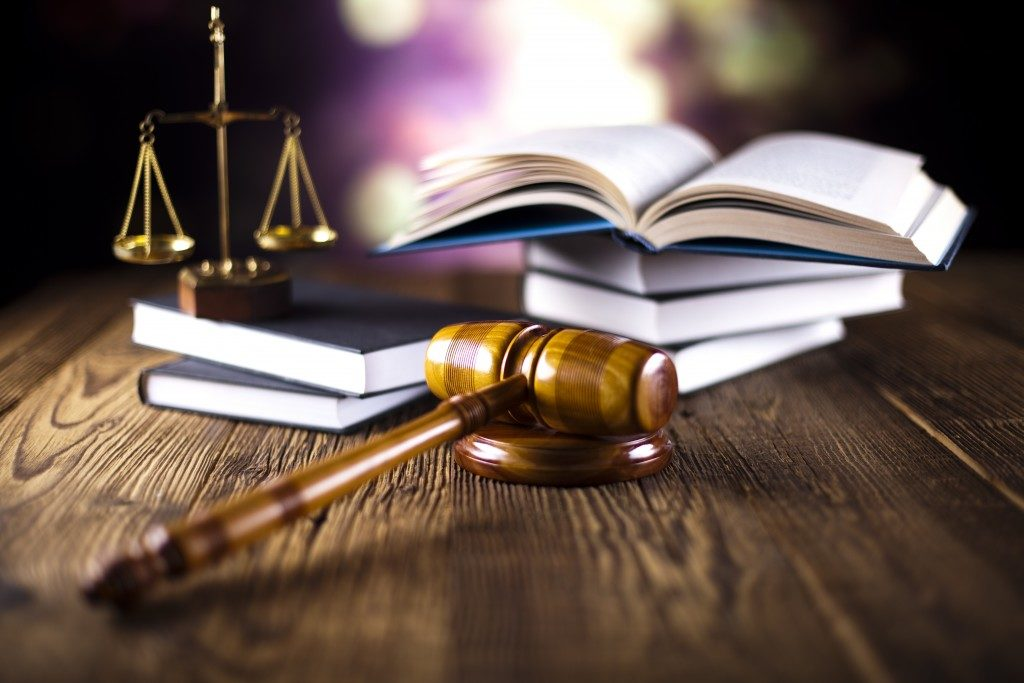 law concept with scale, law books and gavel