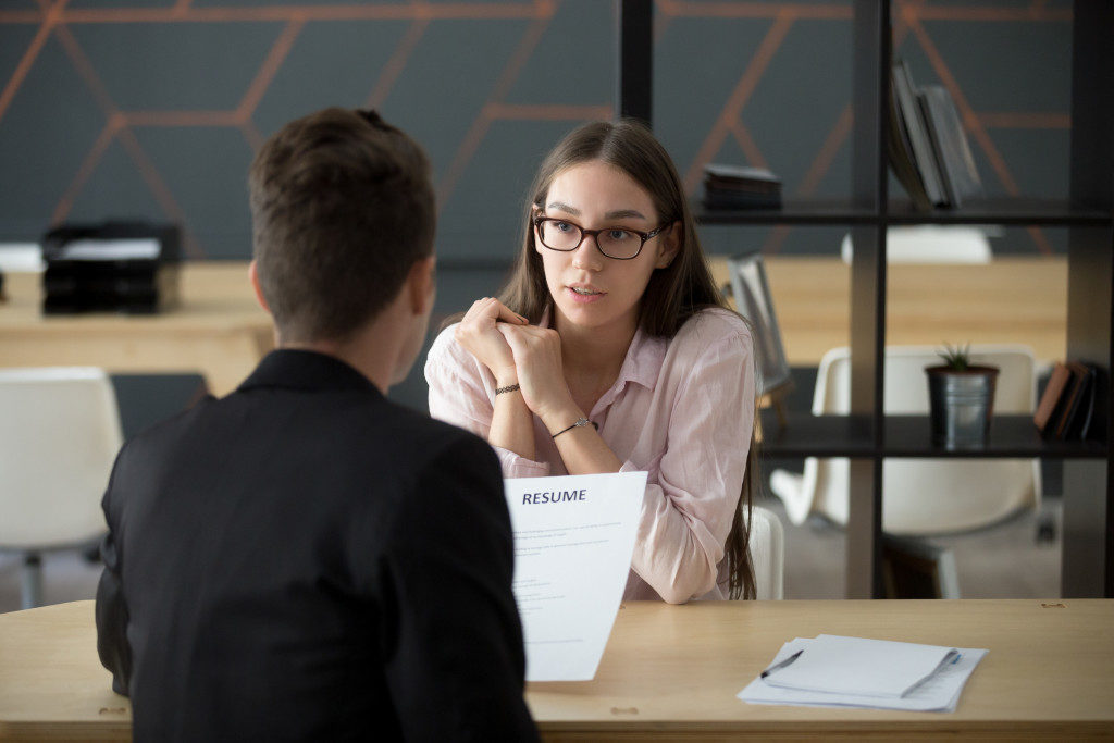 hr personnel interviewing an applicant